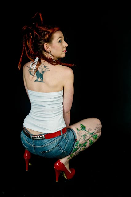 Tattooed model Eve, crouching